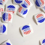"""A table or desk full of """"I Voted"""" stickers from a United States election"""