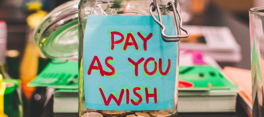 "Tip jar that reads ""Pay as you Wish"""